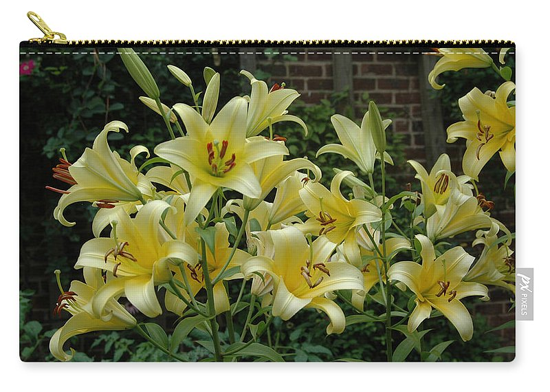 Spring Carry-all Pouch featuring the photograph Yellow Oriental Stargazer Lilies by Tom Wurl