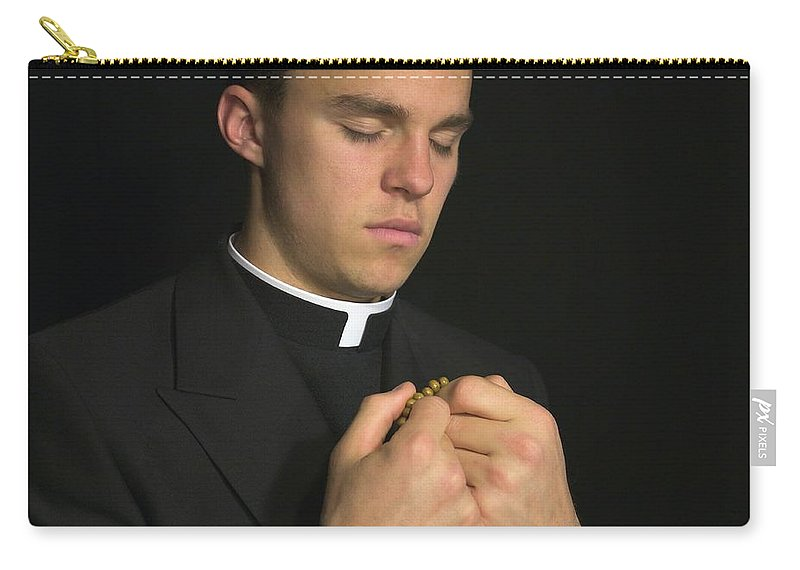Adult Carry-all Pouch featuring the photograph Young Priest Praying With Rosery by Gregory Dean
