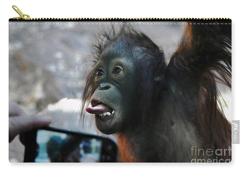 Baby Carry-all Pouch featuring the photograph Baby Orangutan by Savannah Gibbs