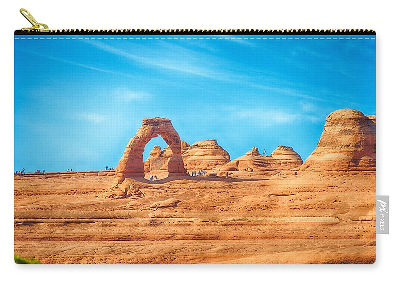 Arches Carry-all Pouch featuring the photograph Famous Delicate Arch In Arches National Park by Alex Grichenko