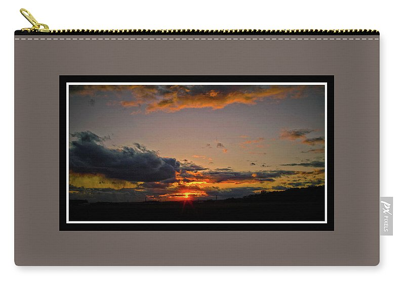 Sunset Carry-all Pouch featuring the photograph 050810-12 by Mike Davis
