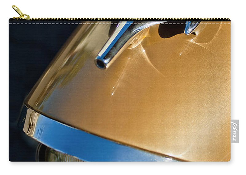 1957 Oldsmobile Super 88 Carry-all Pouch featuring the photograph 1957 Oldsmobile Super 88 Hood Ornament by Jill Reger