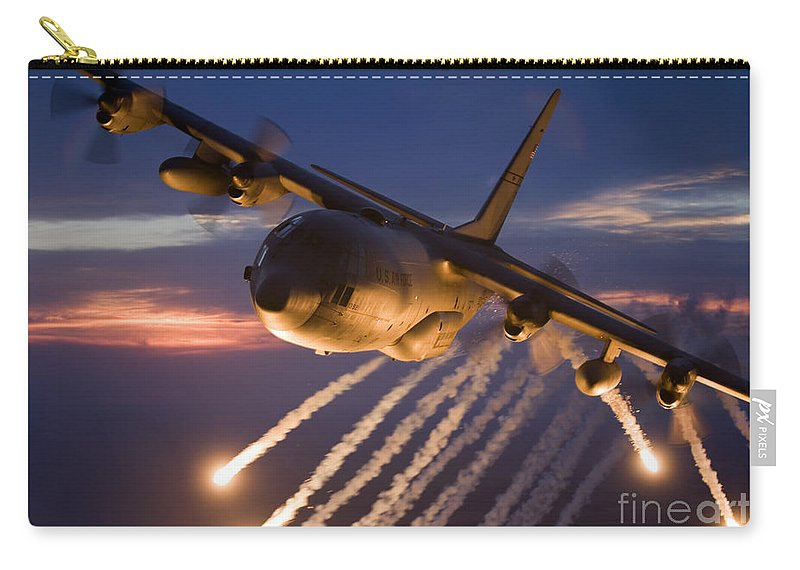 Smoke Carry-all Pouch featuring the photograph A C-130 Hercules Releases Flares 1 by HIGH-G Productions