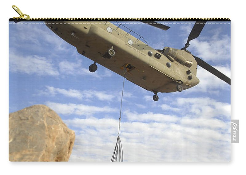 Afghanistan Carry-all Pouch featuring the photograph A U.s. Army Ch-47 Chinook Helicopter by Stocktrek Images