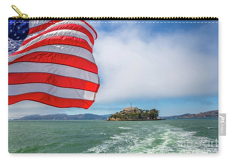 Alcatraz Carry-all Pouch featuring the photograph Alcatraz Island With American Flag by Benny Marty