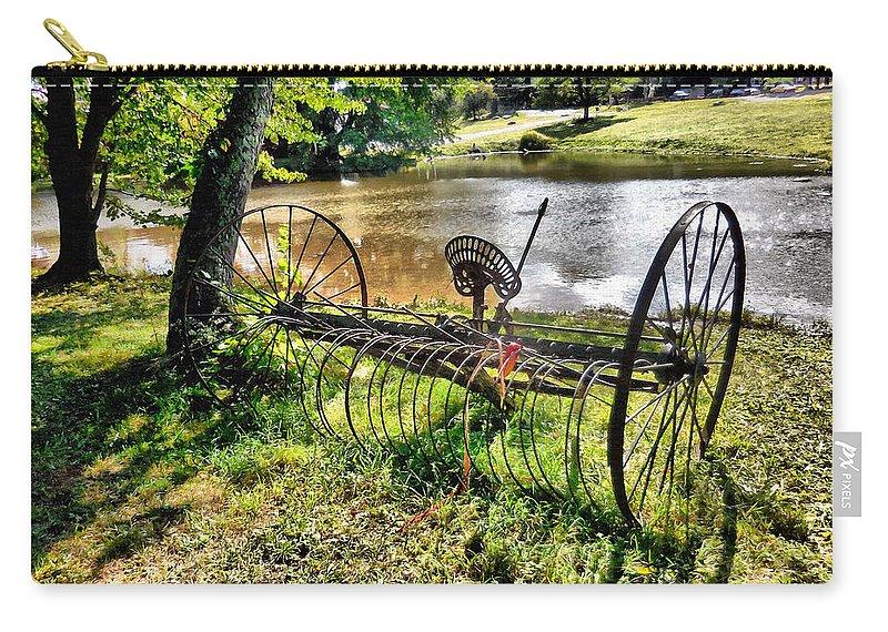 Antique Farm Equipment Carry-all Pouch featuring the painting Antique Farm Equipment 1 by Jeelan Clark
