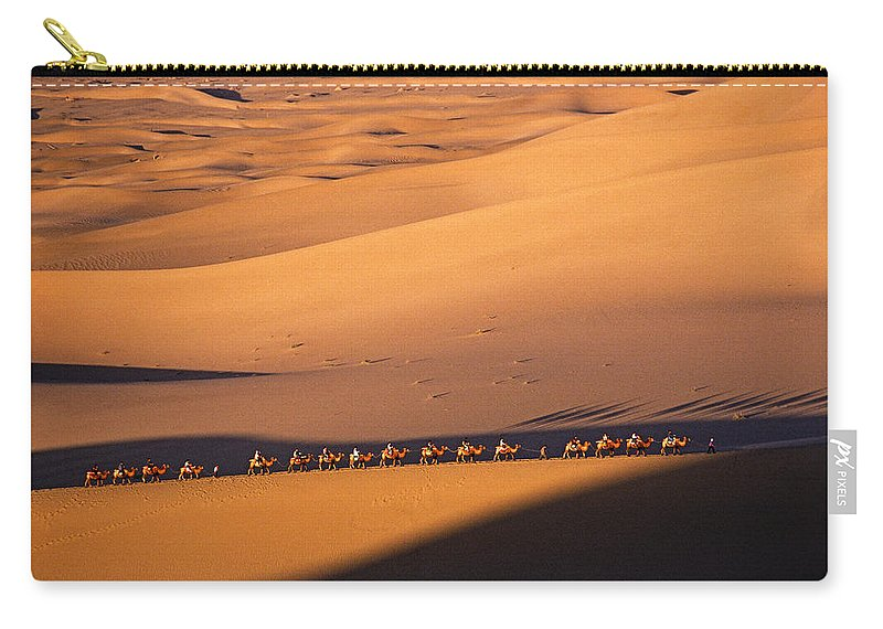 Asia Carry-all Pouch featuring the photograph Camel Caravan Crosses The Dunes by Michele Burgess
