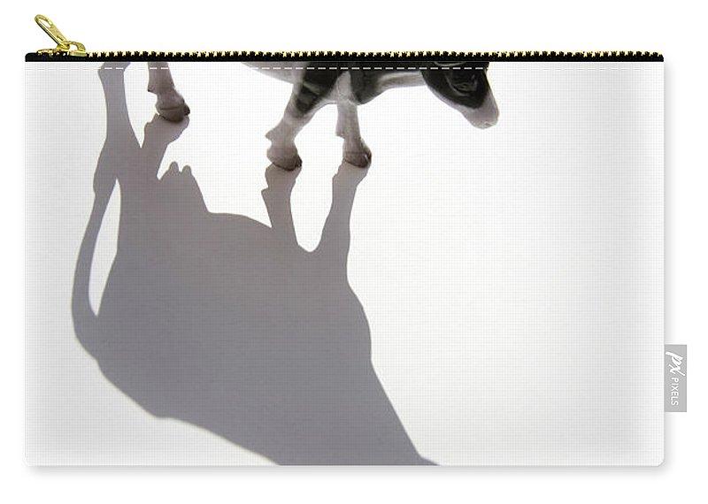 Animal Carry-all Pouch featuring the photograph Cow Figurine by Bernard Jaubert