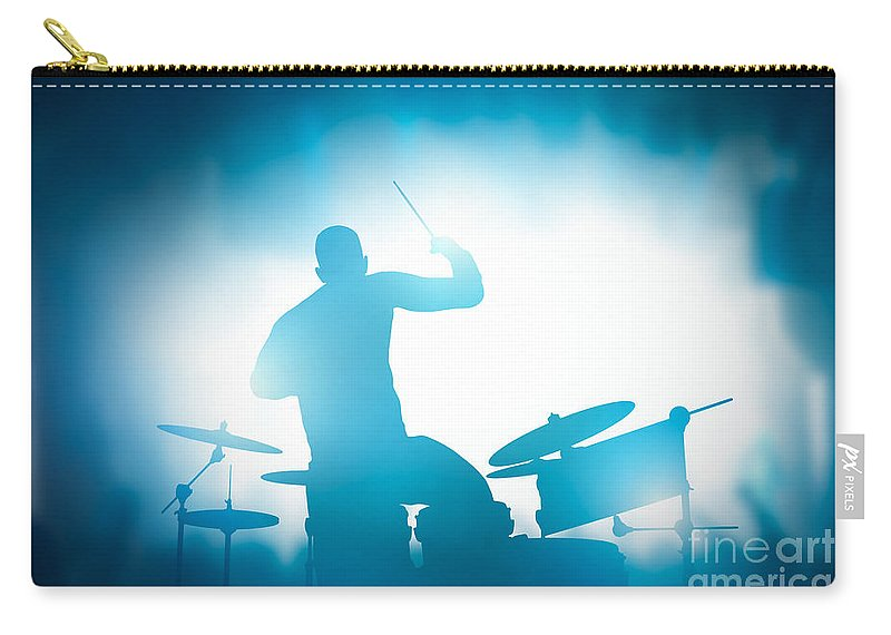 Drums Carry-all Pouch featuring the photograph Drummer playing on drums on music concert. Club lights by Michal Bednarek