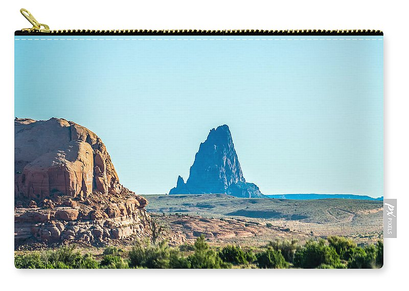 Deserts Carry-all Pouch featuring the photograph El Capitan Peak Just North Of Kayenta Arizona In Monument Valley by Alex Grichenko