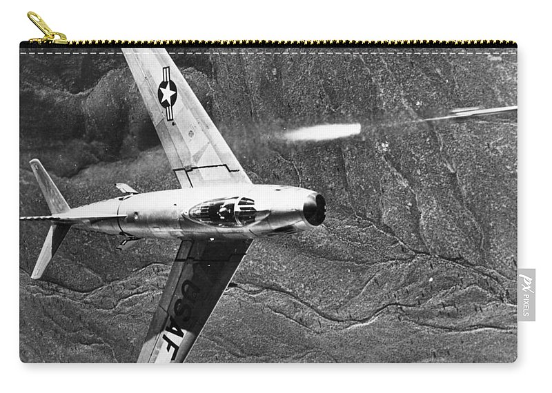 1951 Carry-all Pouch featuring the photograph F-86 Jet Fighter Plane by Granger