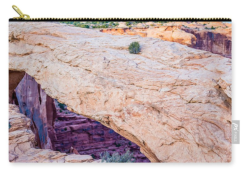 Arch Carry-all Pouch featuring the photograph famous Mesa Arch in Canyonlands National Park Utah USA by Alex Grichenko