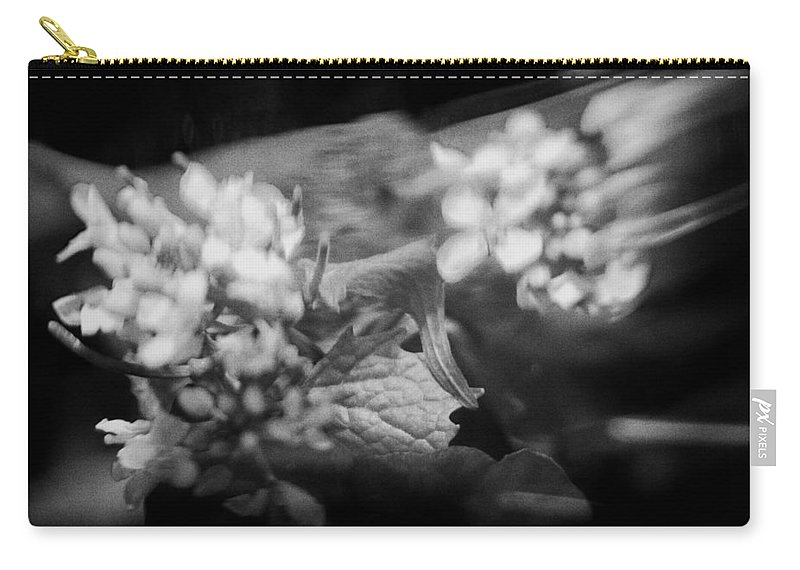 Blacj And White Carry-all Pouch featuring the photograph flowers in Motion by Scott Wyatt