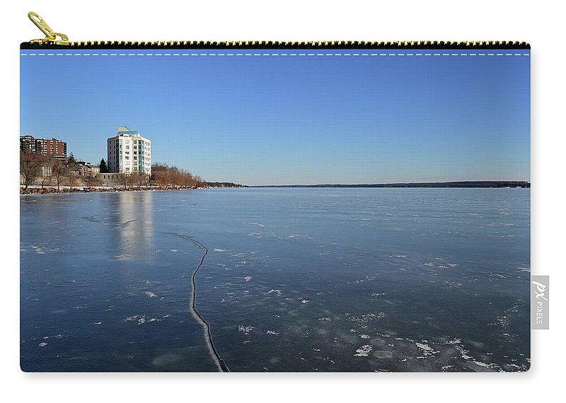 Abstract Carry-all Pouch featuring the photograph Frozen Crack In The Ice by Lyle Crump