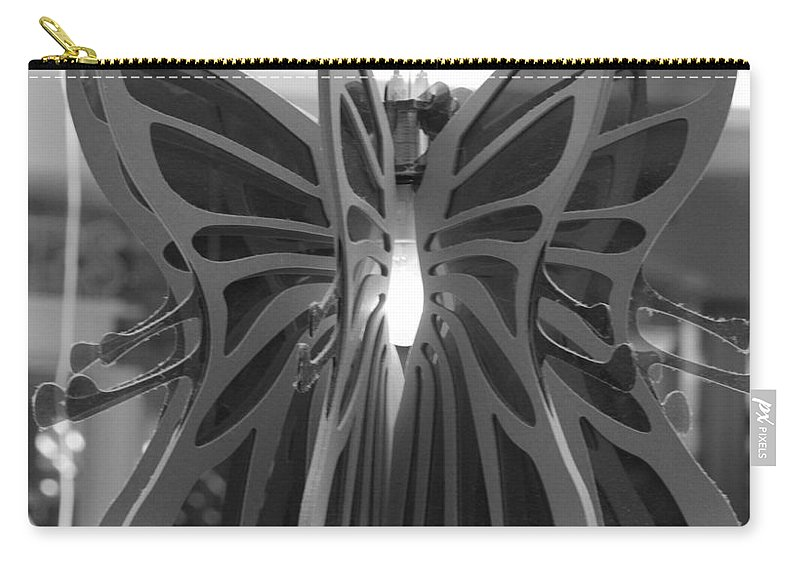 Black And White Carry-all Pouch featuring the photograph Hanging Butterfly by Rob Hans