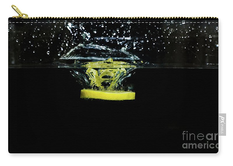 Lemon Carry-all Pouch featuring the photograph Lemon Dropped Into Water by Sharon Zilberczveig