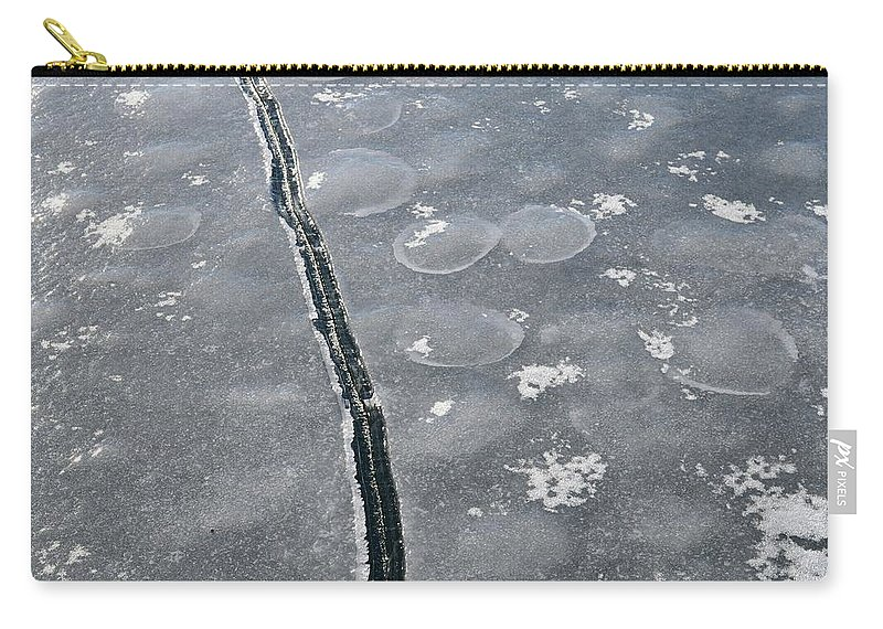 Abstract Carry-all Pouch featuring the photograph Light On The Ice by Lyle Crump