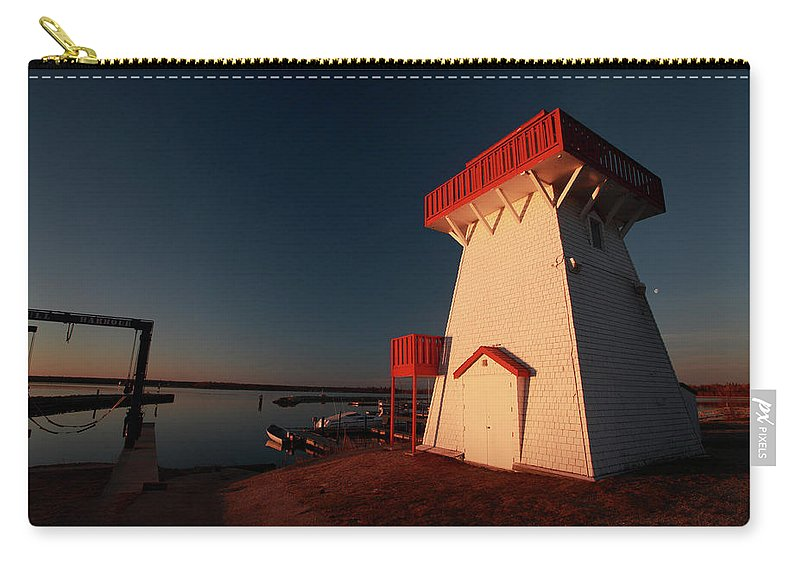 Lighthouse Carry-all Pouch featuring the digital art Lighthouse And Marina At Hecla In Manitoba by Mark Duffy
