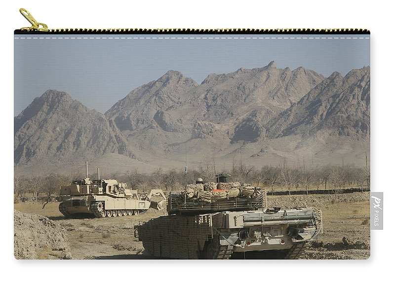 Marines Carry-all Pouch featuring the photograph Marines Conduct Combat Operations by Stocktrek Images