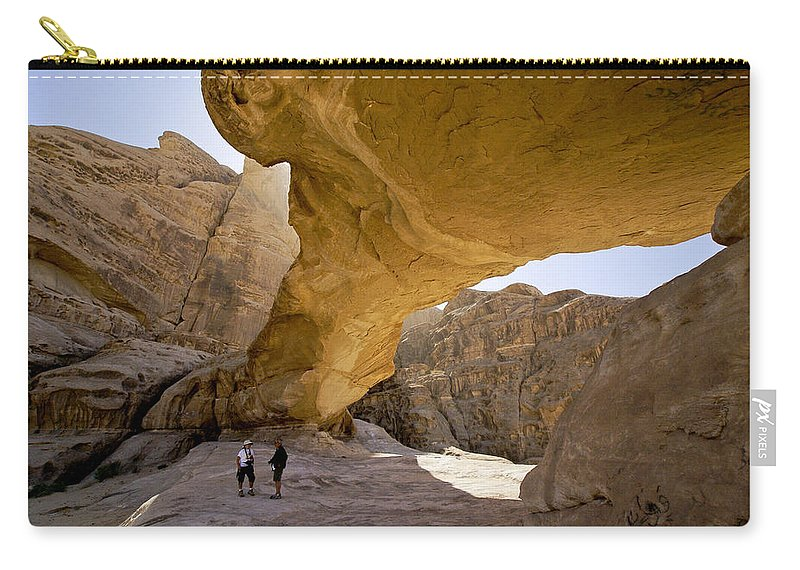 Middle East Carry-all Pouch featuring the photograph Natural Arch In Wadi Rum by Michele Burgess