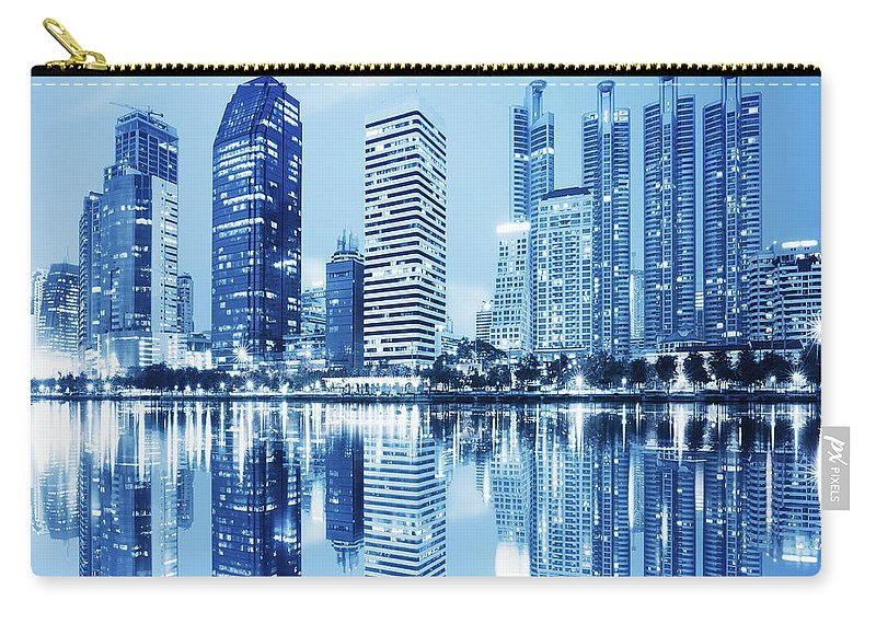 Architecture Carry-all Pouch featuring the photograph Night Scenes Of City by Setsiri Silapasuwanchai