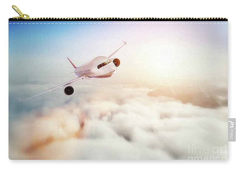 Airplane Carry-all Pouch featuring the photograph Passenger Airplane Flying At Sunset, Blue Sky. by Michal Bednarek