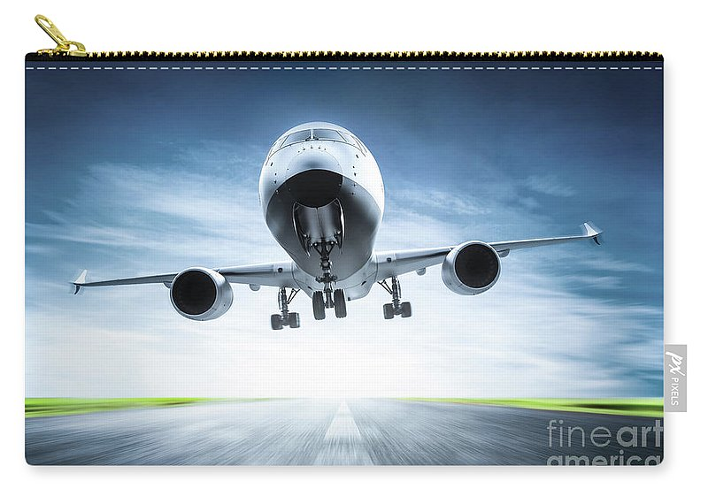 Airplane Carry-all Pouch featuring the photograph Passenger Airplane Taking Off On Runway by Michal Bednarek