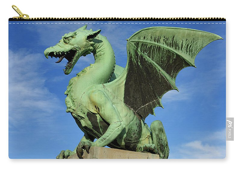 Dragon Carry-all Pouch featuring the photograph Roaring Winged Dragon Sculpture Of Green Sheet Copper Symbol Of by Reimar Gaertner