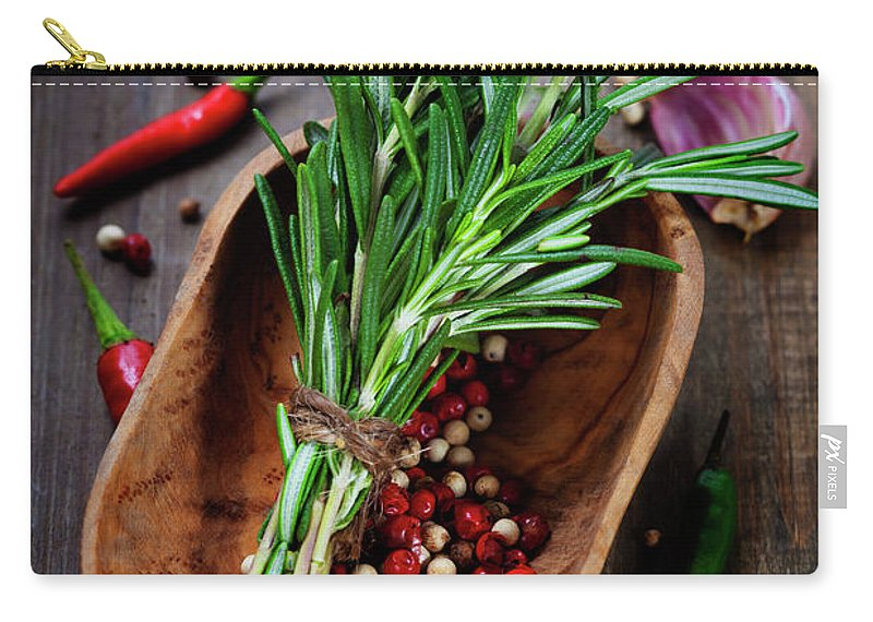 Aroma Carry-all Pouch featuring the photograph Spices On A Wooden Board by Natalia Klenova