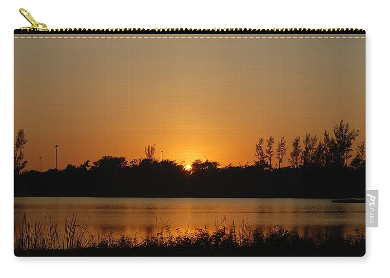 Nature Carry-all Pouch featuring the photograph Sunset On The Edge by Rob Hans