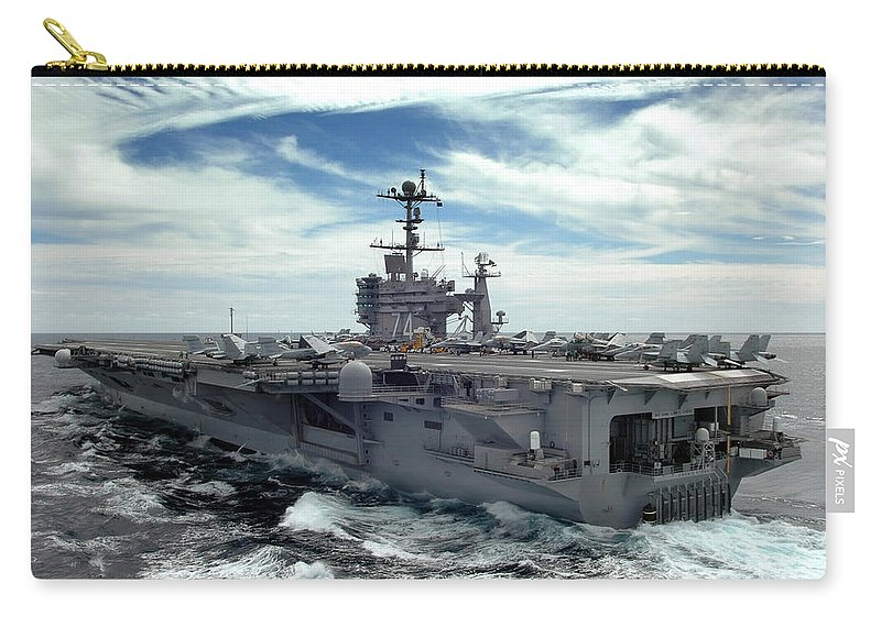 Horizontal Carry-all Pouch featuring the photograph The Nimitz-class Aircraft Carrier Uss by Stocktrek Images