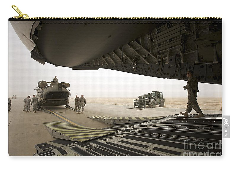 Aviation Carry-all Pouch featuring the photograph Tikrit, Iraq - A Ch-47 Chinook by Terry Moore