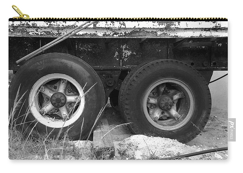 Black And White Carry-all Pouch featuring the photograph Truck Tires by Rob Hans