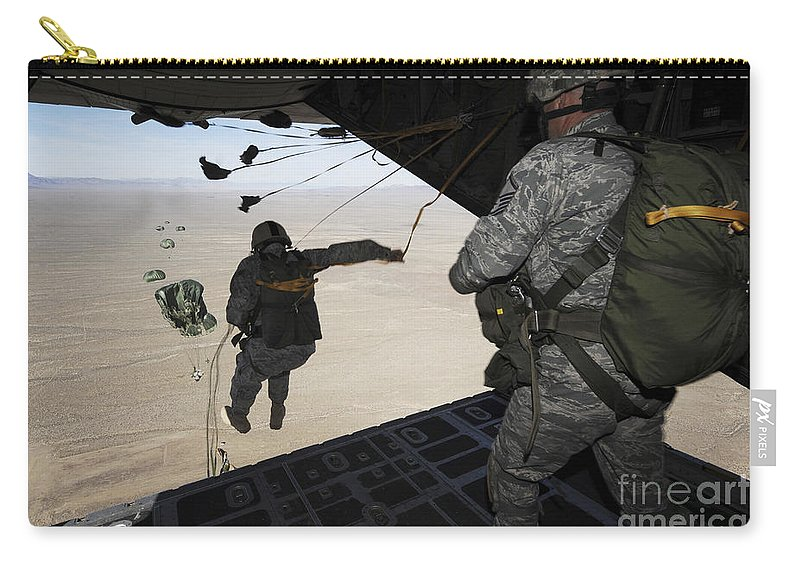 Us Air Force Carry-all Pouch featuring the photograph U.s. Airmen Jump From A C-130 Hercules by Stocktrek Images