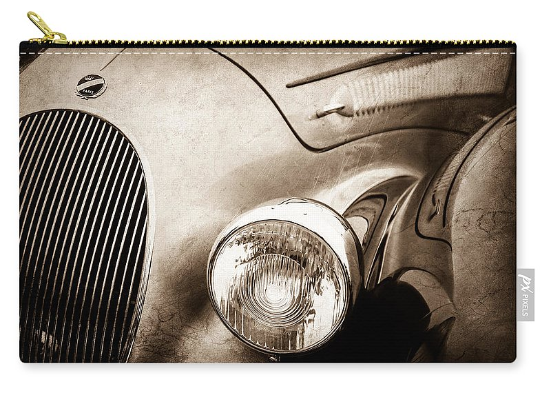 1938 Talbot-lago 150c Ss Figoni And Falaschi Cabriolet Headlight Carry-all Pouch featuring the photograph 1938 Talbot-lago 150c Ss Figoni And Falaschi Cabriolet Headlight - Emblem -1554s by Jill Reger