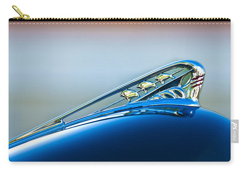 1941 Plymouth Super Deluxe Carry-all Pouch featuring the photograph 1941 Plymouth Hood Ornament by Jill Reger
