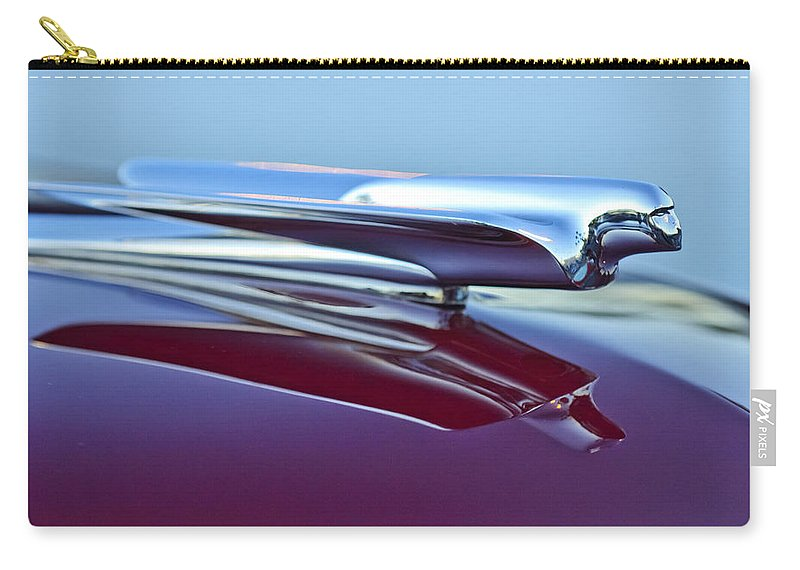 1949 Cadillac Carry-all Pouch featuring the photograph 1949 Cadillac Hood Ornament by Jill Reger