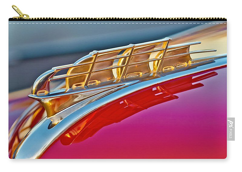 1949 Plymouth Carry-all Pouch featuring the photograph 1949 Plymouth Hood Ornament by Jill Reger
