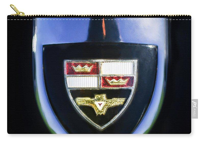1955 Studebaker President Speedster Emblem Carry-all Pouch featuring the photograph 1955 Studebaker President Speedster Emblem -0496c45 by Jill Reger