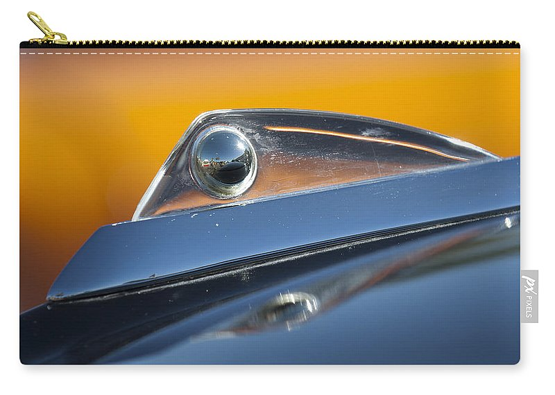 1961 Ford Starliner Carry-all Pouch featuring the photograph 1961 Ford Starliner Hood Ornament by Jill Reger