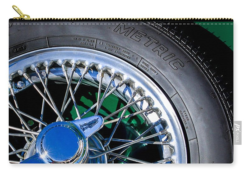 1964 Morgan 44 Spare Tire Emblem Carry-all Pouch featuring the photograph 1964 Morgan 44 Spare Tire by Jill Reger