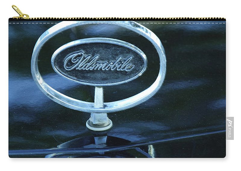 1975 Oldsmobile Carry-all Pouch featuring the photograph 1975 Oldsmobile Hood Ornament by Jill Reger
