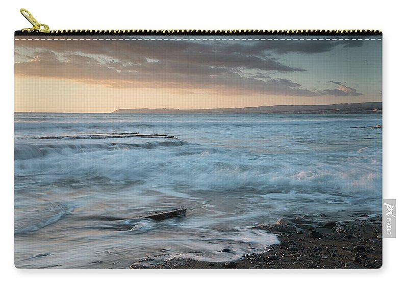 Seascape Carry-all Pouch featuring the photograph Beautiful Dramatic Sunset Over A Rocky Coast by Michalakis Ppalis