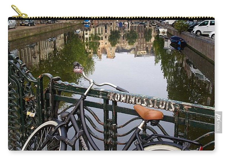 Herengracht Canal Carry-all Pouch featuring the photograph Bicycle Parked At The Bridge In Amsterdam. Netherlands. Europe by Bernard Jaubert