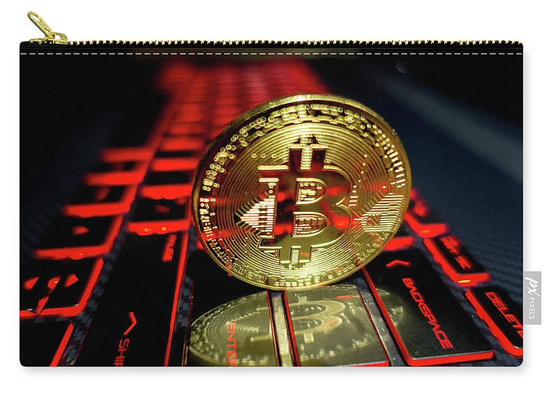 Keyboard Carry-all Pouch featuring the photograph Bitcoin Coin L On Laptop Keyboard by Alex Grichenko
