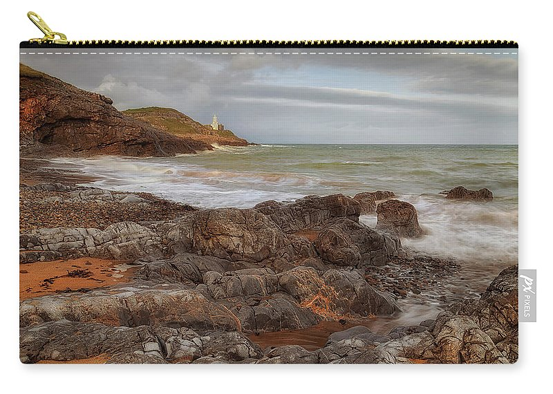 Bracelet Bay Carry-all Pouch featuring the photograph Bracelet Bay And Mumbles Lighthouse by Leighton Collins