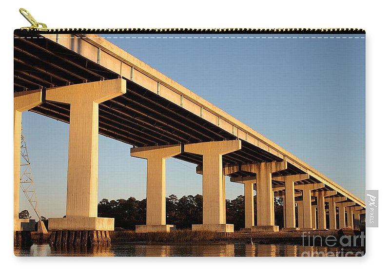 Architecture Carry-all Pouch featuring the photograph Bridge Pilings by Thomas Marchessault