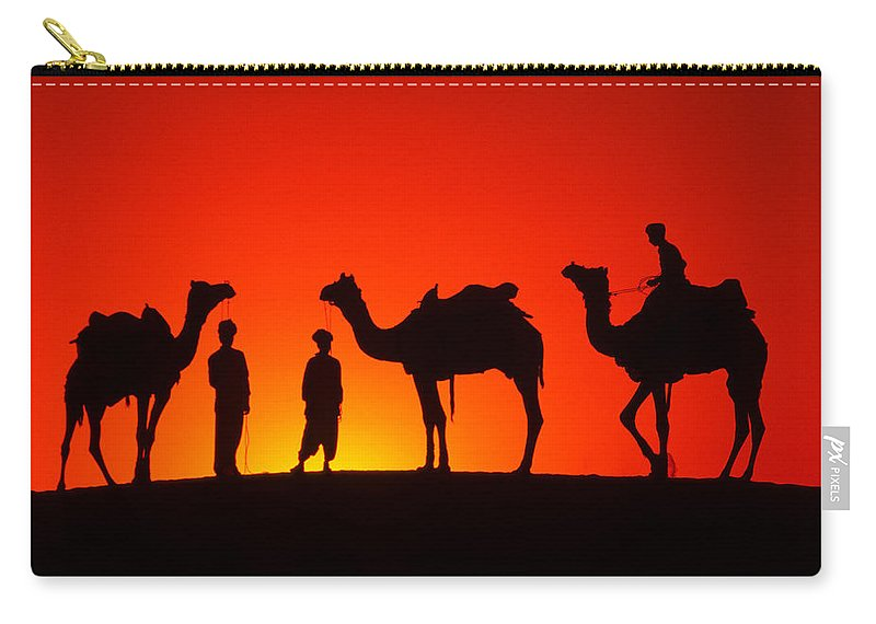 India Carry-all Pouch featuring the photograph Camels At Sunset by Michele Burgess