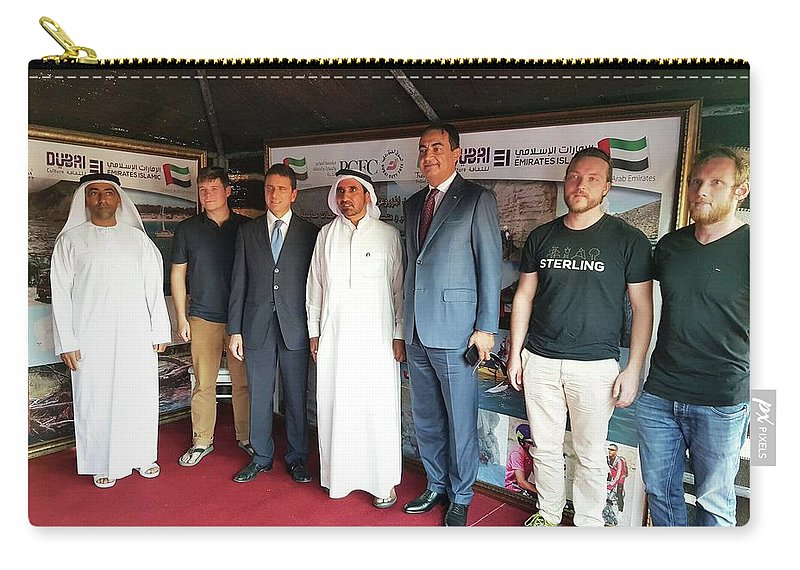 Carry-all Pouch featuring the digital art Dubai Travelers Festival by Mohamed Dekkak