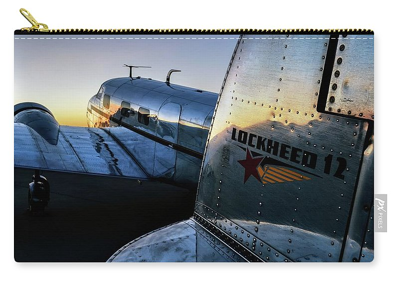 Airshow Carry-all Pouch featuring the photograph Electra Daybreak by Chris Buff